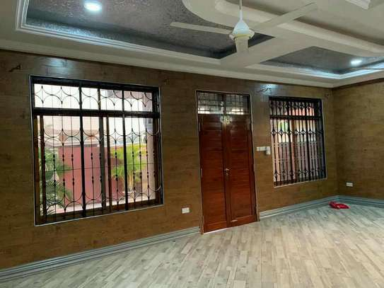 a 3bedrooms standalone is for rent at kunduchi image 3
