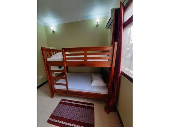 shortay rent $30 per bed a beautfuly house located  at ununio image 4
