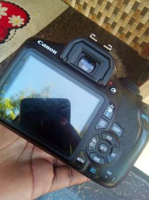 Canon 1200 D with lens 18 _130 image 1