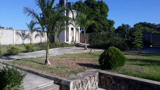 4 bed room house for sale at mapinga bagamoyo , house with big terrace and swimming pool image 4