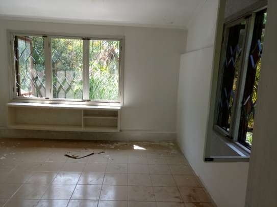 small 1bed shared house at masaki near sea cliff court tsh 600,000 image 9