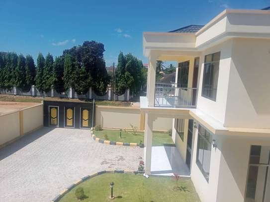 4bed town house for sale at mbezi beach  next to the beach