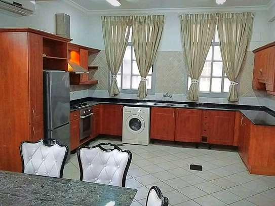 MIKOCHENI  SHOPPERS PLAZA..a 4bedrooms  VILLA is available for rent at mikocheni cool street u can find in tz image 8
