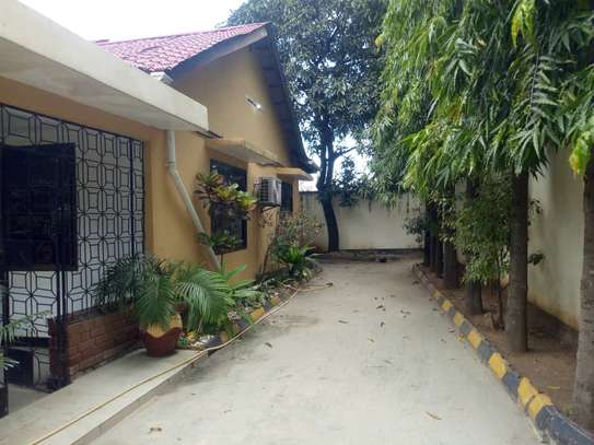 4 bed room big house with nice garden at mikocheni image 4