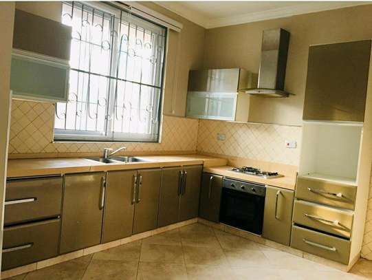 a 3bedrooms VILLAS only 2 in compound with swimming pool also close to main raod at mbezi beach is for rent image 6