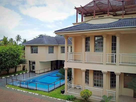 MIKOCHENI  SHOPPERS PLAZA..a 4bedrooms  VILLA is available for rent at mikocheni cool street u can find in tz image 1