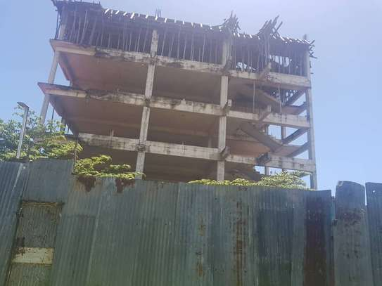 Unfinished 4 storeys building for sale at Masaki