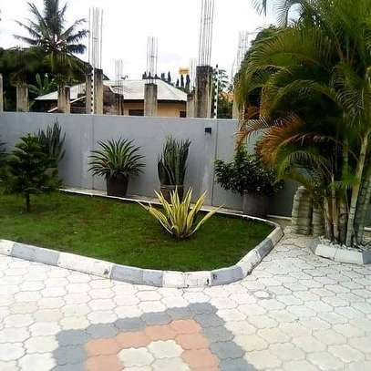 HOUSE FOR SALE AT MBEZI BEACH....a 4bedrooms with a servant cotter image 5