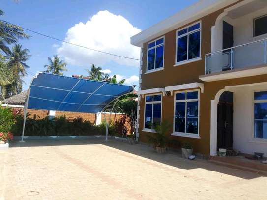 a 3bedrooms standalone near the main road and also close to shoppers mbezi beach is now available for rent image 1