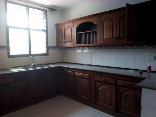 3bed house for office  along main rd at mikocheni a image 12