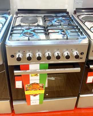 Von Hotpoint Cooker  F6B31E2.ES 3 Gas Burners +1electric Hotplate & Electric Oven. Silver Splash Lid. 60x60