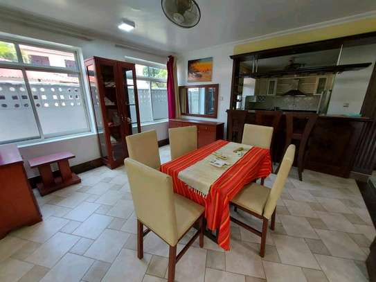 a 3bedrooms fully furnished standalone in mikocheni with a paved street image 4