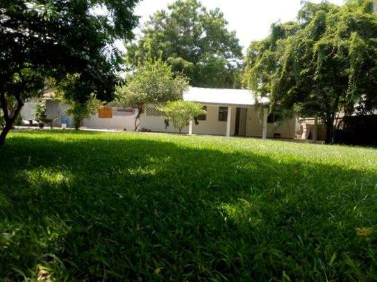 small 1bed shared house at masaki near sea cliff court tsh 600,000 image 8