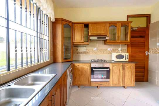 a VILLA  2bedrooms fully furnished is available for rent at mbezi beach road to whitesands hotel image 4