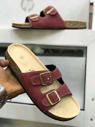 Men's and women's leather slides.
