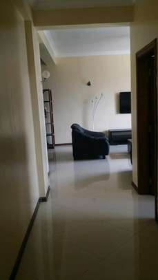 a 3bedrooms fully furnished appartment are avaiable for rent at msasani with a very cool paved road street image 2