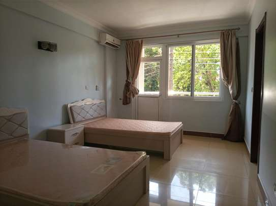 4 bedrooms fully furnished apart for rent at msasani beach image 4