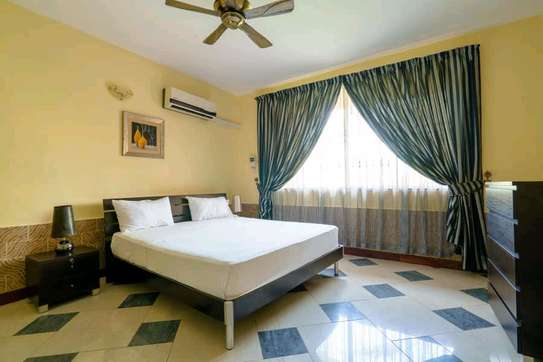 a VILLA  2bedrooms fully furnished is available for rent at mbezi beach road to whitesands hotel image 5