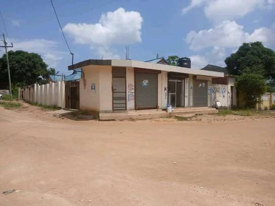 Two house for sale at kinyerezi ilala dar-es salam each have independent luku contains 3bedrooms dining,siting rooms ,kitchen with 3business frems and this is the corner plot  at price of tzsh 170m afordable and negotiable image 5