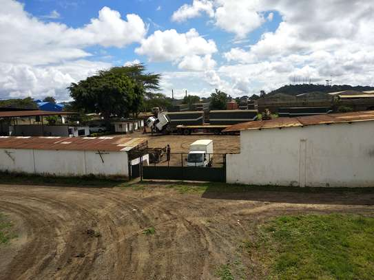 Large Walled Plot with Warehouses in Njiro image 3