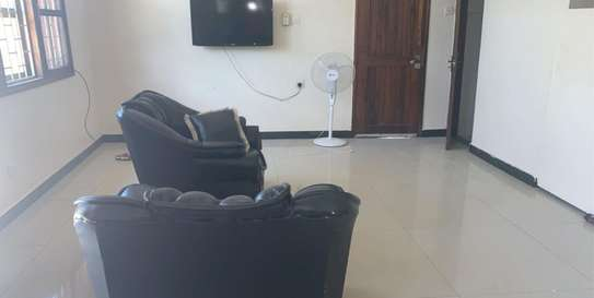 2bed in the compound ground floor big parking of 8 car at mikocheni a image 5