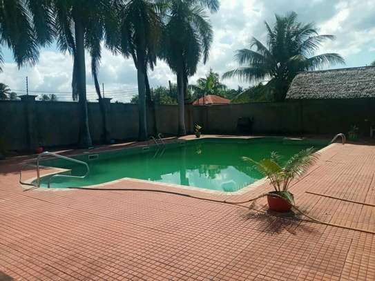 a stand alone mansion is for rent at mbezi beach near mediteranian hotel street very cool neighbour hood image 3