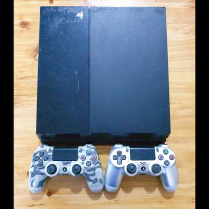 PS4 6 GAMES AND 2 CONTROLLERS image 1