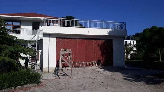 4 bed room house for sale at mapinga bagamoyo , house with big terrace and swimming pool image 10