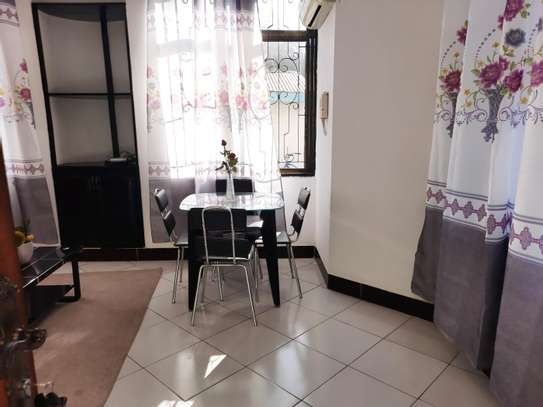 a 1bedroom fully furnished at mikocheni very close to shoppers plaza on a paved road image 3