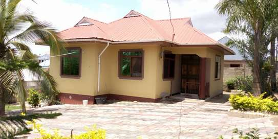3bed house for sale by bank at goba magati bus stop and 6 frem tsh 65million image 2