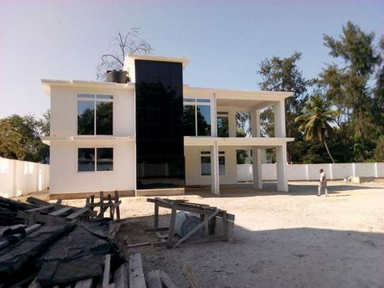 4bed room ensuite at mbezi beach with big compound next to the beach $15000 image 2