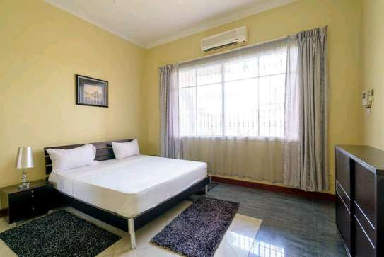 a 2bedrooms  VILLAS fully furnished in MBEZI BEACH is available for rent now image 4