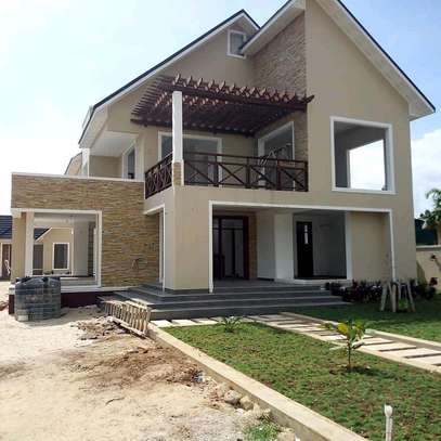 3  BDRM SEMI-FINISHED HOUSE WITH A SERVANTS' QUARTER  AT BAHARI BEACH, DAR ES SALAAM. image 1