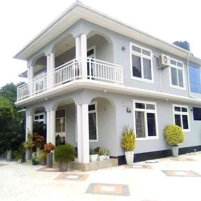 HOUSE FOR SALE AT MBEZI BEACH....a 4bedrooms with a servant cotter image 1