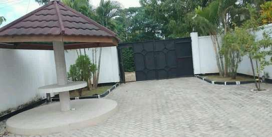 a stand alone house is for rent at mbezi beach near shoppers plaza