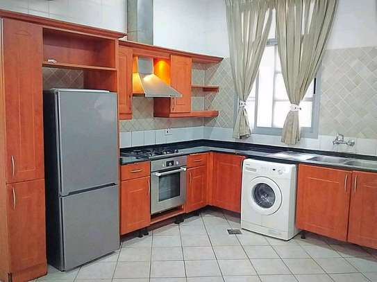 MIKOCHENI  SHOPPERS PLAZA..a 4bedrooms  VILLA is available for rent at mikocheni cool street u can find in tz image 7