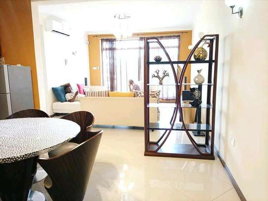 a fully furnished appartment with  a  beach view is available for rent at cool neighbour street at msasani image 2