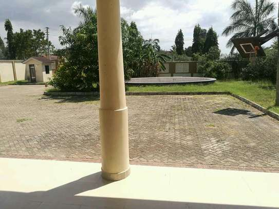 a stand alone bungalow is for rent at mbezi beach near shoppers plaza image 3