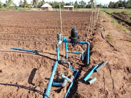 Irrigation system installation in farm image 1