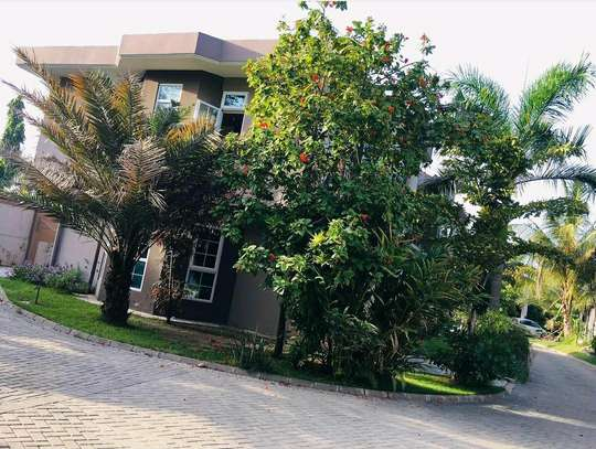 a 3bedrooms VILLAS only 2 in compound with swimming pool also close to main raod at mbezi beach is for rent image 2
