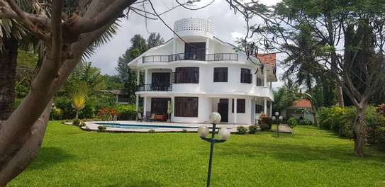 7bed  beach house for sale at kawe beach 4800sqm  clear white sand image 1