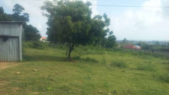 3 actre plot along main rd ideal for  hotel or apartment with sea view $1m