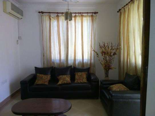 2bed furnished all  ensuet at mikocheni$400pm image 2