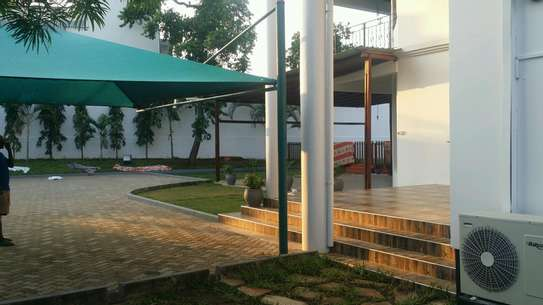 a luxurious standalone mansion is for rent at masaki walkind distance to the beach image 2