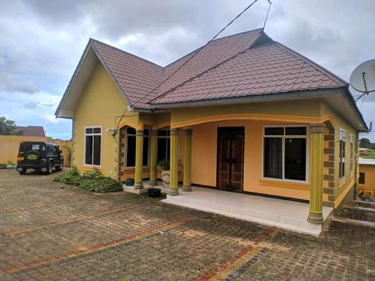 4BEDROOMS HOUSE 4SALE TSHS180MLN AT KIGAMBONI image 4