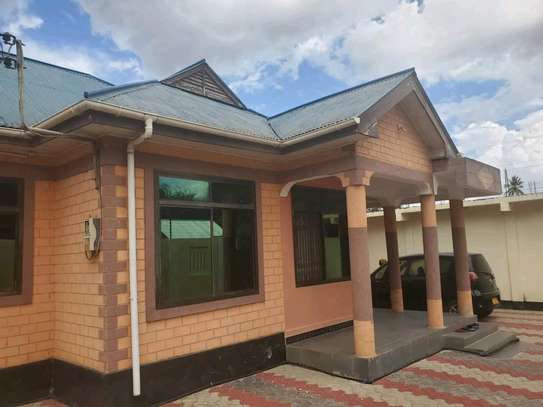 Two house for sale at kinyerezi ilala dar-es salam each have independent luku contains 3bedrooms dining,siting rooms ,kitchen with 3business frems and this is the corner plot  at price of tzsh 170m afordable and negotiable image 1