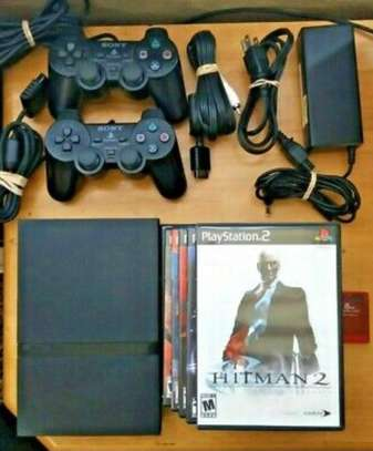 Sony PlayStation 2 Slim Bundle PS2 with 2 controllers 7 games Hitman 2 image 1