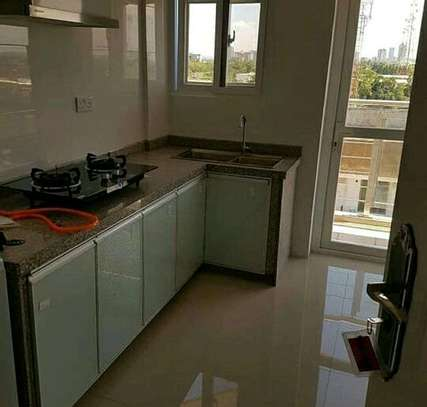 a 2 bedrooms fully furnished appartment is available for rent at msasani very cool neighbour hood image 4