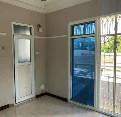 a standalone house is for rent at mbezi beach close by the road...suitable for office or family use image 3