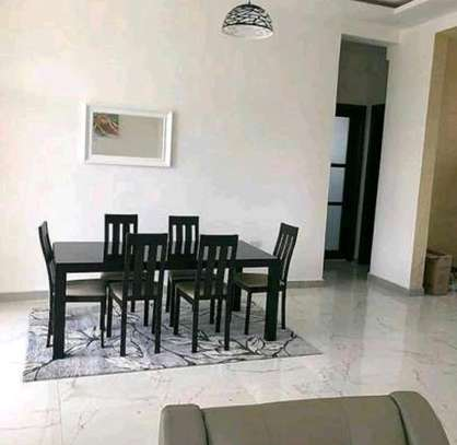 a 2bedrooms fully furnished appartments with a very decent environment at mbezi beach on paved road image 4